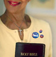 Woman with Bible and campaign buttons